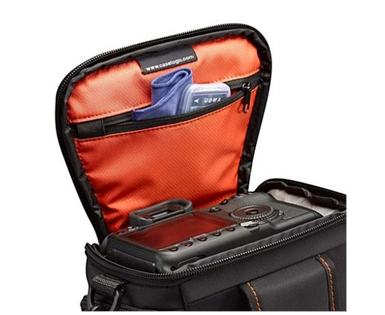 Case Logic DCB-306 Black, * Designed to fit an SLR camera with standard zoom lens attached * Internal zippered pocket stores memory cards, filter or lens cloth * Side zippered pockets store an extra battery, cables, lens cap, or small accessories * Lid un, фото 2